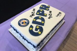 """Cake with """"GDPR"""" in frosting"""